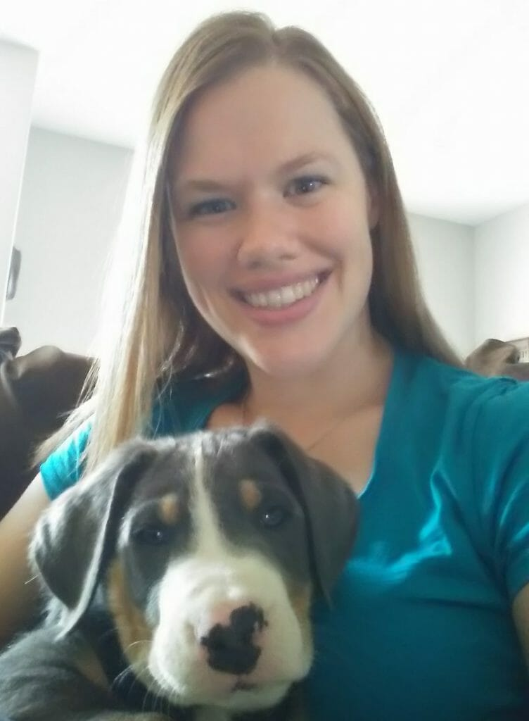 Dr. Kelsey Milmine with a dog