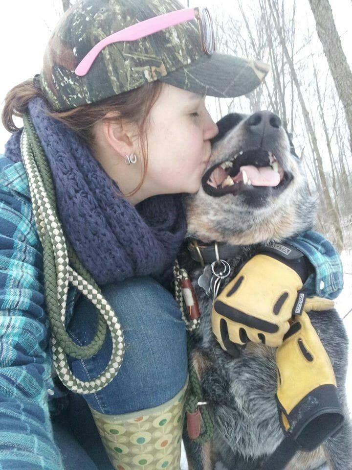 Jessica kissing Dingo the dog